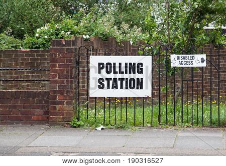 LONDON, UNITED KINGDOM - JUNE 8, 2017: A polling station sign is hanged outside during the British general elections in South London, United Kingdom on June 8, 2017.