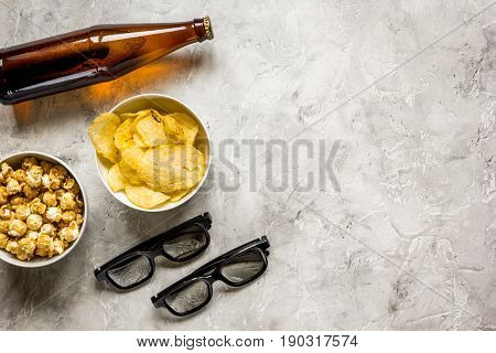 cinema and TV whatching with beer, chips and pop corn on stone background top view mock-up