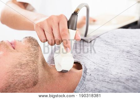Man Being Checked For Thyroid At Ultrasound Device In A Hospital