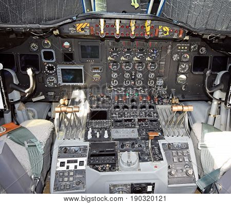 Interior view of old turbioprop airplane cockpit and instruments