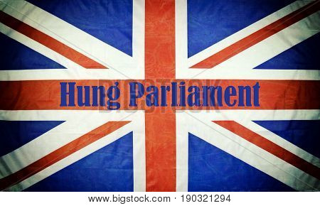 Close up of a British flag with Hung Parliament text for the General Election and texture and vignette.
