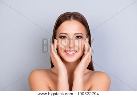 Beauty And Health Concept. Young Attractive Girl Is Touching Gently Her Attractive Healthy Smooth Sk