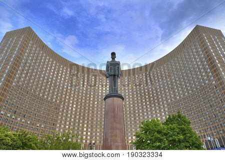 MOSCOW JUN 8 2017: View of famous french president Charles De Gaulle monument in front of famous international Hotel Cosmos curved building USSR Russia architecture. World famous monuments
