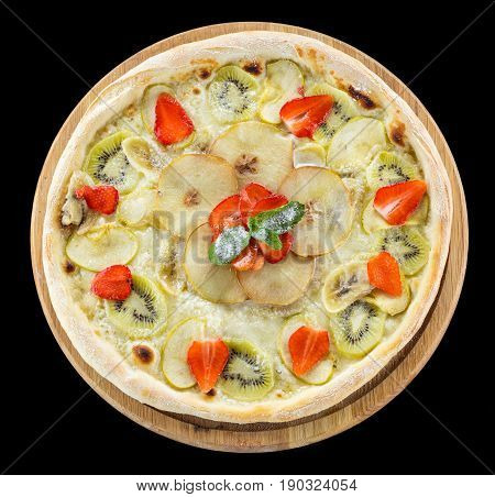 Fruit pizza over black background view from above