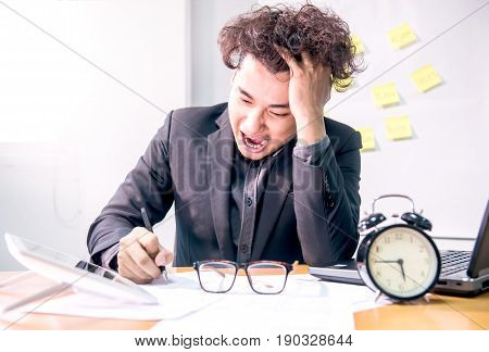 busy and headache person unsuccessful businessman with deadline