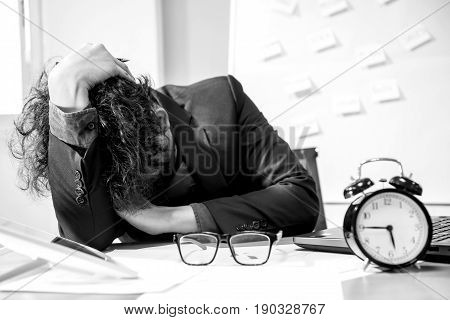 busy and headache person unsuccessful businessman in office