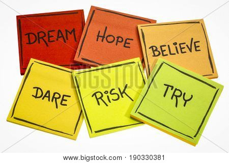 dream, hope, believe, dare, risk, try - motivational concept - a set of isolated sticky notes with handwriting