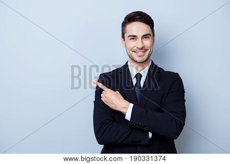 Close Up Portrait Of Young Successful Brunete  Stock-market Broker Guy On The Pure Light Blue Backgr