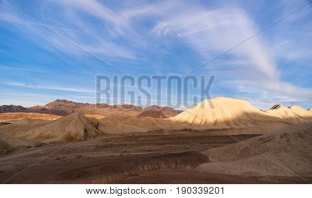 national; desert; park; death; valley; landscape; sky; california; sand; mountains; nature; southwest; travel; rock; geological; scenic; badlands; dunes; wild; cracked; tourism; natural; canyon; horizon; american; west; western; famous; sandstone; skyline