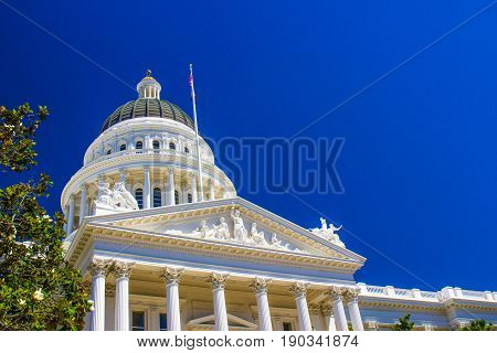 Statues, Dome And Turret On Capitol Building