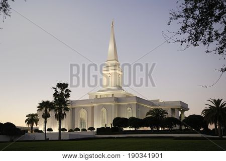 Orlando Temple of the Church of Jesus Christ of Latter-day Saints at dusk.