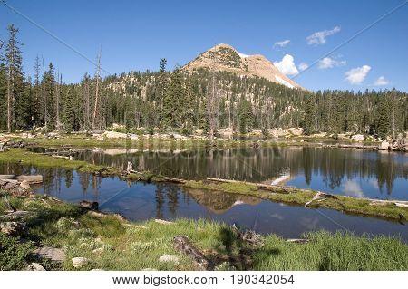 Beautiful scenic lake reflection taken in the High Uintas in Utah