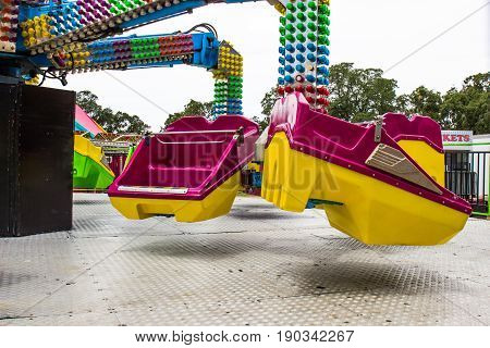 Two Bucket Seats On Ride At Small County Fair