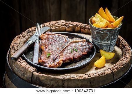 Tasty Chips And Tbone Steak On Old Barrel