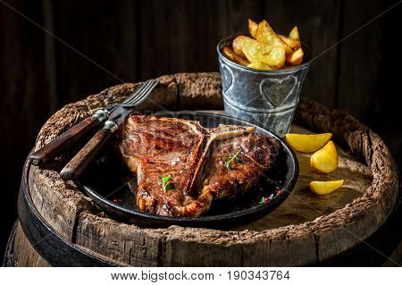 Chips And Tbone Steak On Old Barrel