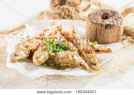 Roasted Smelt Fish With Salt And Herbs On White Background