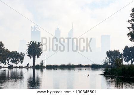 The Swan River and skyline of Perth City, Western Australia, on a hazy (smoke haze) morning. June 1st, 2017.