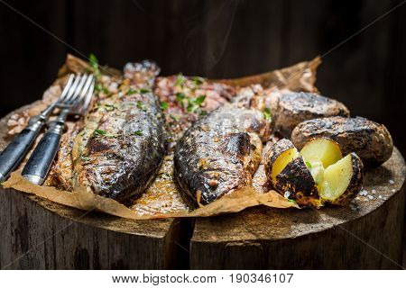 Closeup Of Fresh Potatoes And Trout Fish With Butter