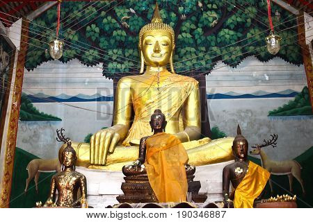 Buddha statue beautiful in the church of Wat Kae Temple at Suphanburi Thailand.