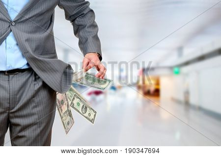 Photo of a man pulling out empty pockets