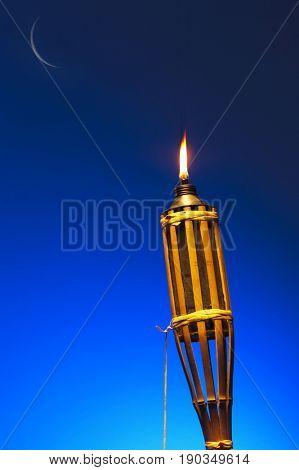 burning oil lamp in blue background