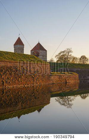 Kuressaare Episcopal castle and moat with water in sunset light Saaremaa Estonia