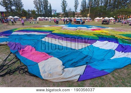 Chiang Mai Thailand - 4 March 2016 - Deflated hot-aired ballon lays on the ground at Chiang Mai Ballon Festival in Chiang Mai Thailand on March 4th 2016