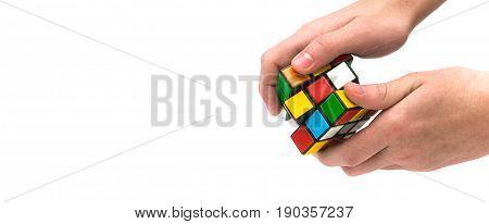 Estonia, Tallinn, May 30, 2017. Rubik's cube in hand on white background