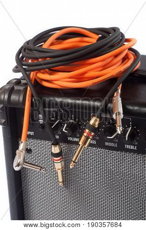 Close-up of guitar amplifier with jack cable.
