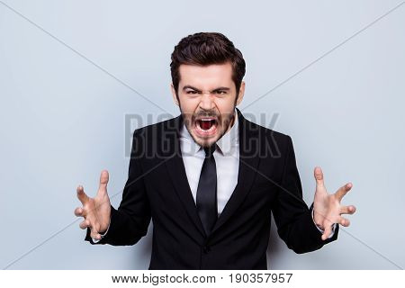 Portrait Of Angry Overworked Businessman Sreaming In Rage Because Of Having No Time To Finish His Pr