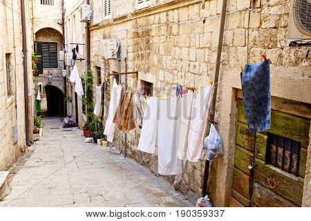 Narrow city street in Dubrovnik Dalmatia - Croatia.