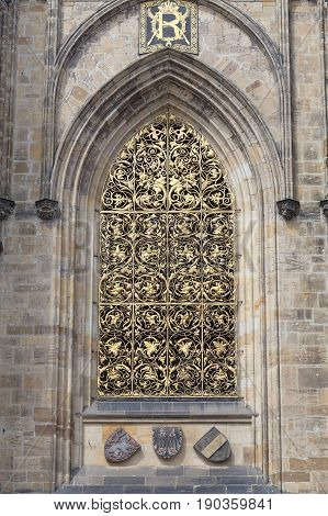 14th century St. Vitus Cathedral facade window with golden ornament Prague Czech Republic. It is a Roman Catholic metropolitan cathedral in Prague the seat of the Archbishop of Prague.