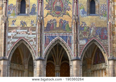 14th century St. Vitus Cathedral facade mosaic Last Judgment over Golden Gate Prague Czech Republic. It is a Roman Catholic metropolitan cathedral in Prague the seat of the Archbishop of Prague