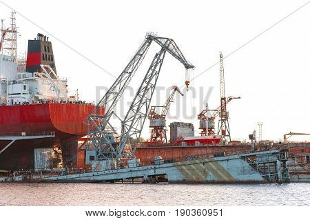 Floating cargo crane and part of cargo ship at the shipyard docks.Terminal in Riga. Outdoors.