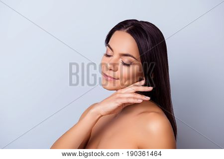 So cute and pure! Young pretty hispanic mulatto charming girl is touching gently her shining healthy bronze skin poster