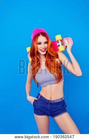 Be A Star! Foxy Young Attractive Girl With Skate Board On Blue Background. Ginger Is So Colorful, Ho