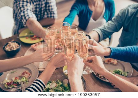 Cropped Close Up Photo Of Glasses With Champagne. Young People Are Toasting To Celebrate The Event.