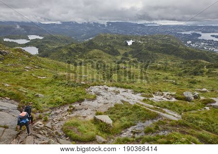 Norwegian landscape with hikers. Ulriken mountain. Bergen surroundings area. Norway