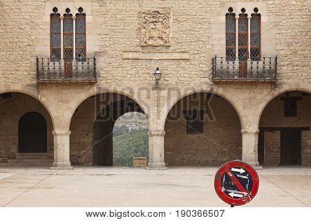 Picturesque stoned arcaded square in Spain. Cantavieja No parking.