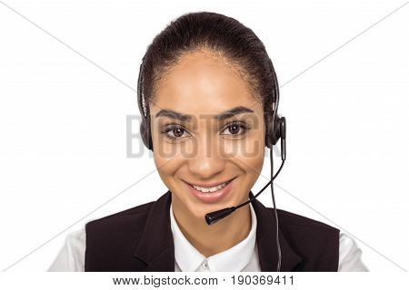 Smiling young african american call center operator in headset looking at camera