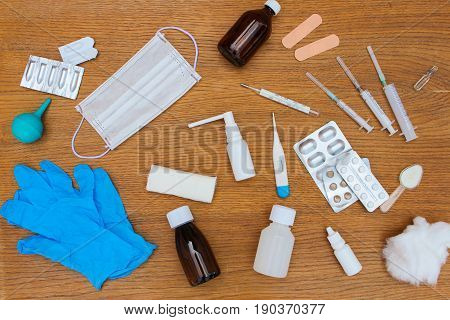 Medical items, pills on table. Top view.