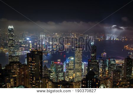 Aerial Night View From Victoria Peak To Kowloon Bay And Illuminated Skyscrapers Of Hong Kong Island,