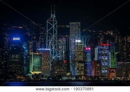 Night View Of Hong Kong Central Business District Illuminated Skyscrapers From Kowloon, Hong Kong, C