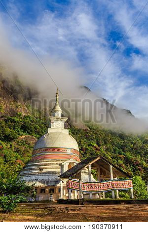 Buddist Stupa With Green Mountains And Blue Sky, On The Way To The Top Of Adam's Peak, Sri Lanka