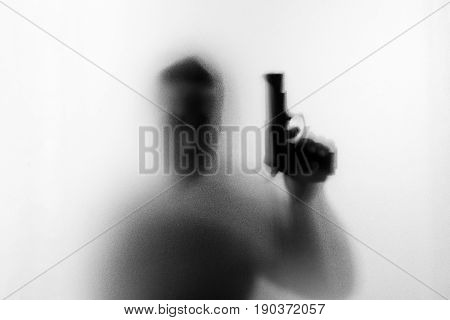 Shadow Of Horror Man Killer With A Gun In His Left Hand.dangerous Man Behind The Frosted Glass.myste