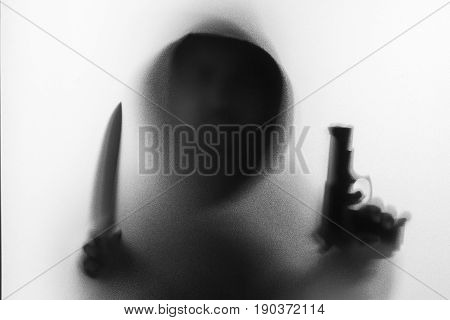 Shadow Blur Of Horror Man In Jacket Hold Knife In Right Hand And Hold Gun In Left Hand.dangerous Man