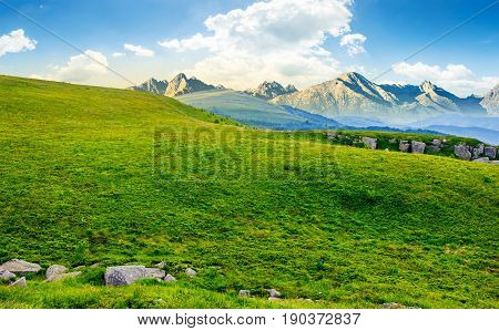 Meadow With Huge Stones On Top Of Mountain Range
