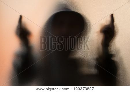 Shadow Blur Of Horror Man In Jacket With Hood.middle Finger Symbol Fuck You On The Glass.dangerous M