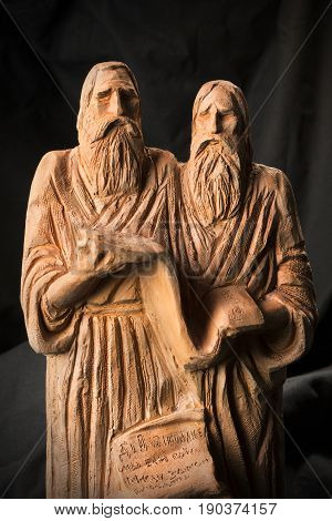 Slavonic Educators Cyril And Methodius Clay Statues Close Up Image. Old Men Hold Scroll Of Holy Scri