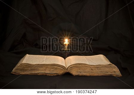 Open Book With Light Spotlight On Text. Reading Of Opened Book Educate Reader. Ancient Bible Text Re